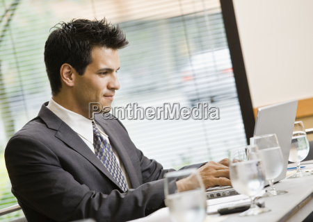 man in business suit smiling with