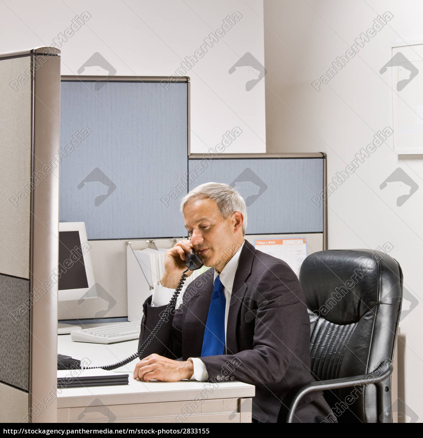businessman, talking, on, telephone, at, desk - 2833155