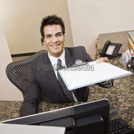 young, man, holding, clipboard - 2833589