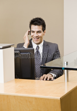 young, man, in, suit, talking, on - 2833709