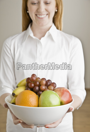 young woman with bowl of fruit