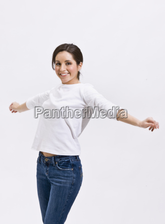 cute brunette standing with outstretched arms