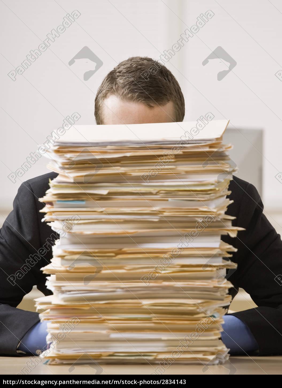 businessman, behind, stack, of, file, folders - 2834143