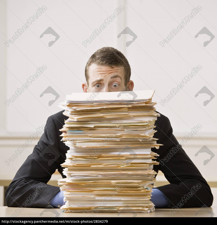 businessman, behind, stack, of, file, folders - 2834279