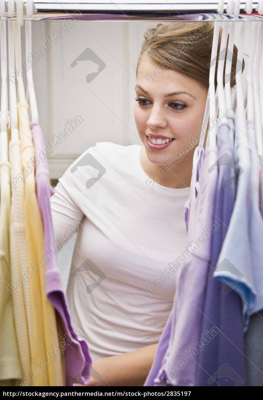 beautiful, young, woman, looking, through, closet - 2835197