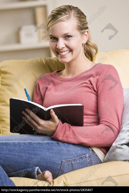 teenage, girl, writing, in, book - 2835807