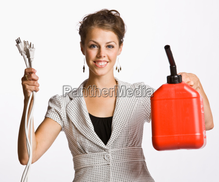 businesswoman holding electrical plugs and gas