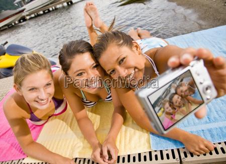 friends taking portrait with digital camera