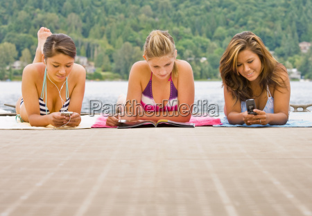 friends laying on pier