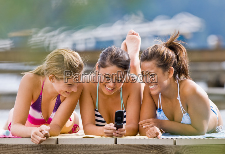 friends text messaging with cell phone