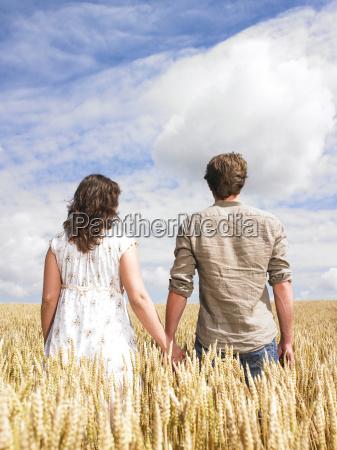 couple hugging in wheat field