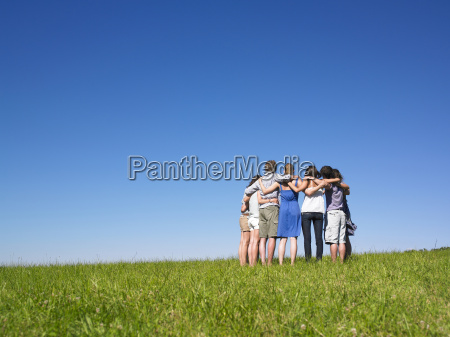 group of people in huddle in