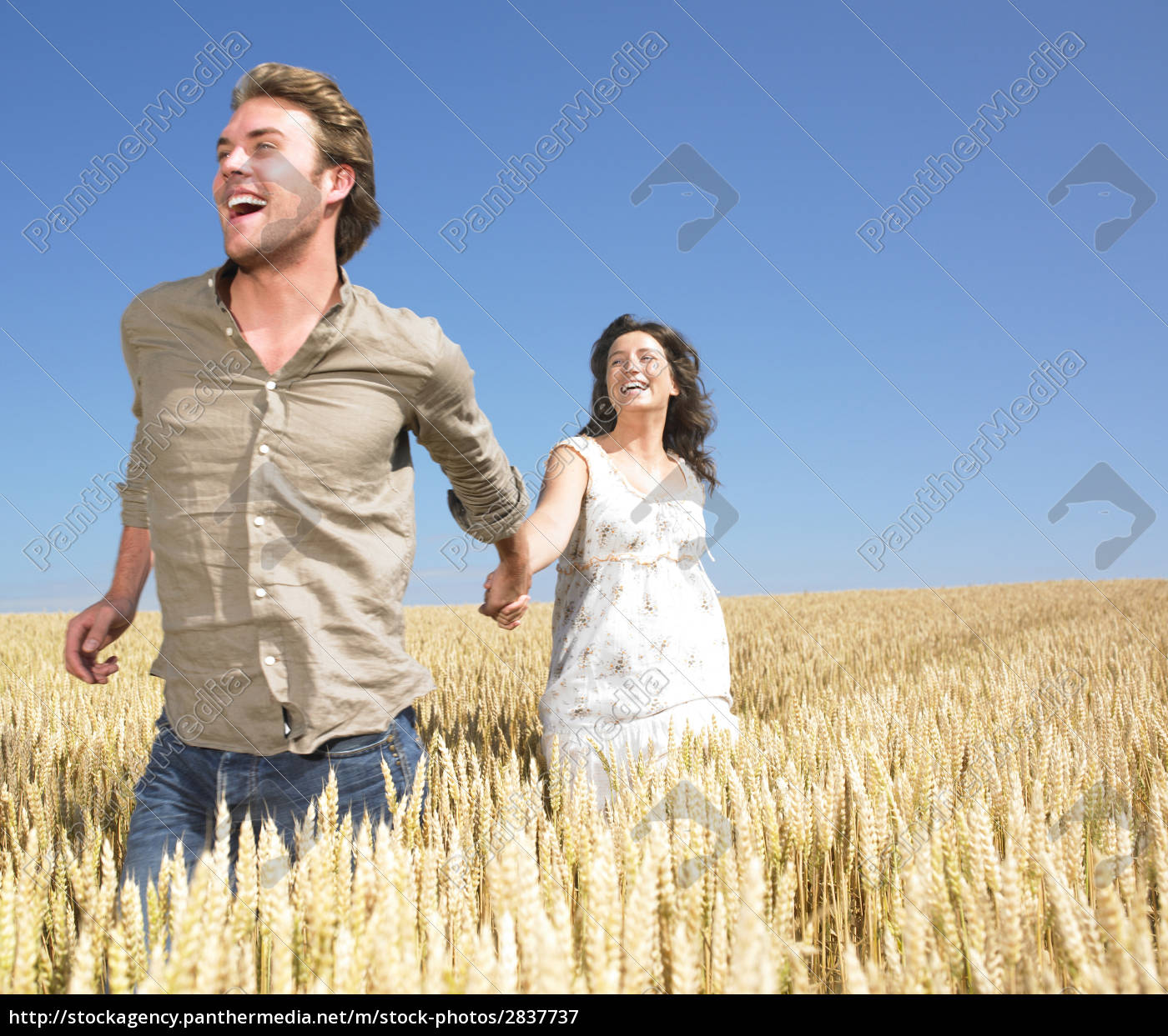 couple, running, in, wheat, field - 2837737