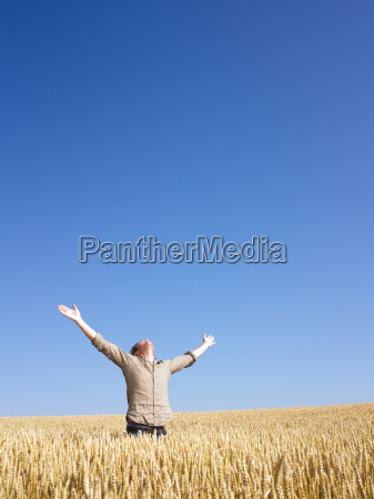 man, in, wheat, field, with, arms - 2837479