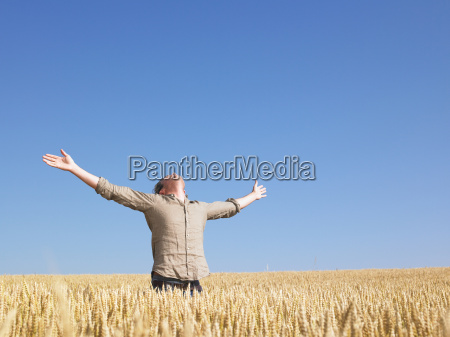 man, in, wheat, field, with, arms - 2837563