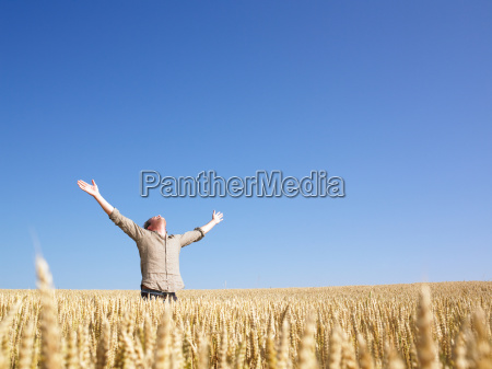 man, in, wheat, field, with, arms - 2837725