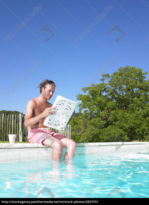 man, reading, at, edge, of, swimming - 2837551