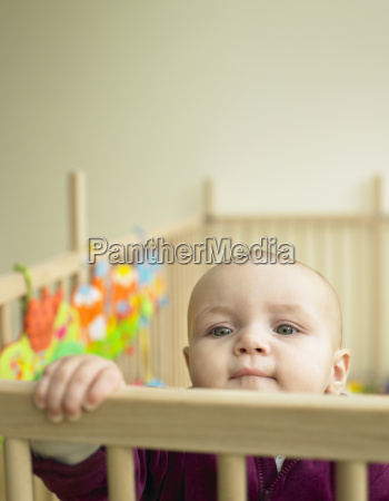 baby, looking, out, of, playpen - 2838089