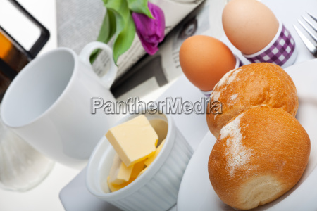 eggsbreadbutter and coffee on white background