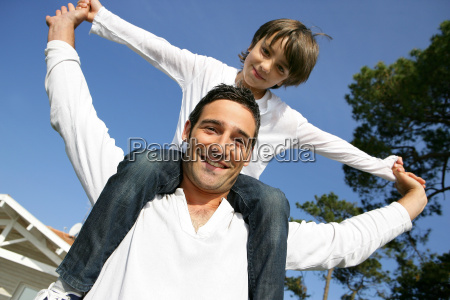 little boy sitting on the shoulders