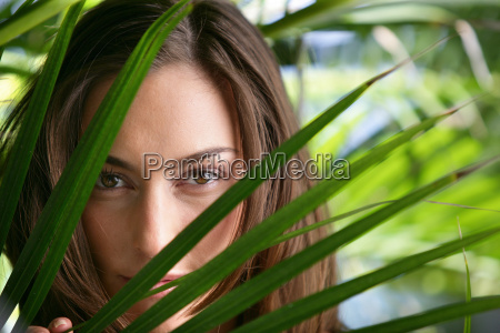 front view, character, outdoors, beauty, young woman, behind a palm leaf - 2899081