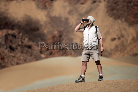 looking, man, walking, away, with, binoculars - 2899127
