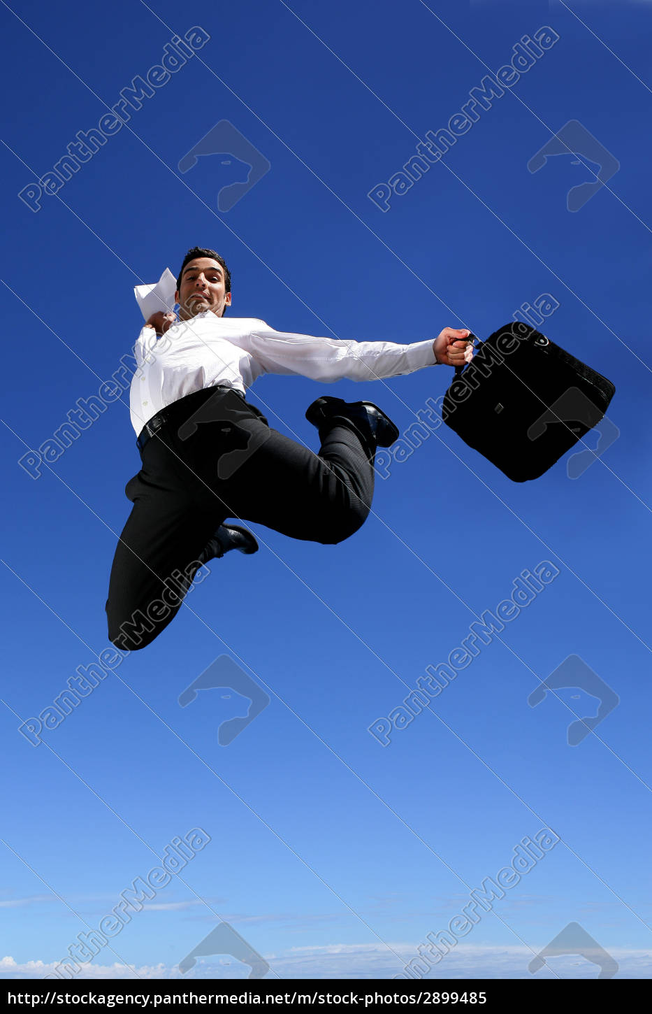 man, in, suit, with, briefcase, jumping - 2899485