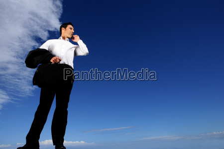 man, in, suit, with, mobile, phone - 2899681