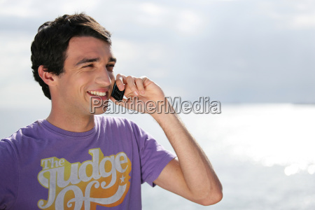 portrait, of, smiling, man, with, mobile - 2899997