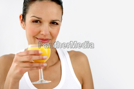 portrait, of, smiling, woman, with, orange - 2899781