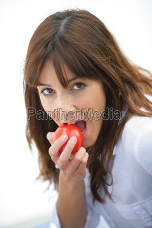 portrait, of, a, woman, biting, into - 2900129