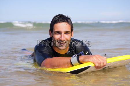 portrait, of, man, overboard, with, bodyboard - 2900105