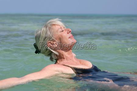 elderly woman bathing in the sea