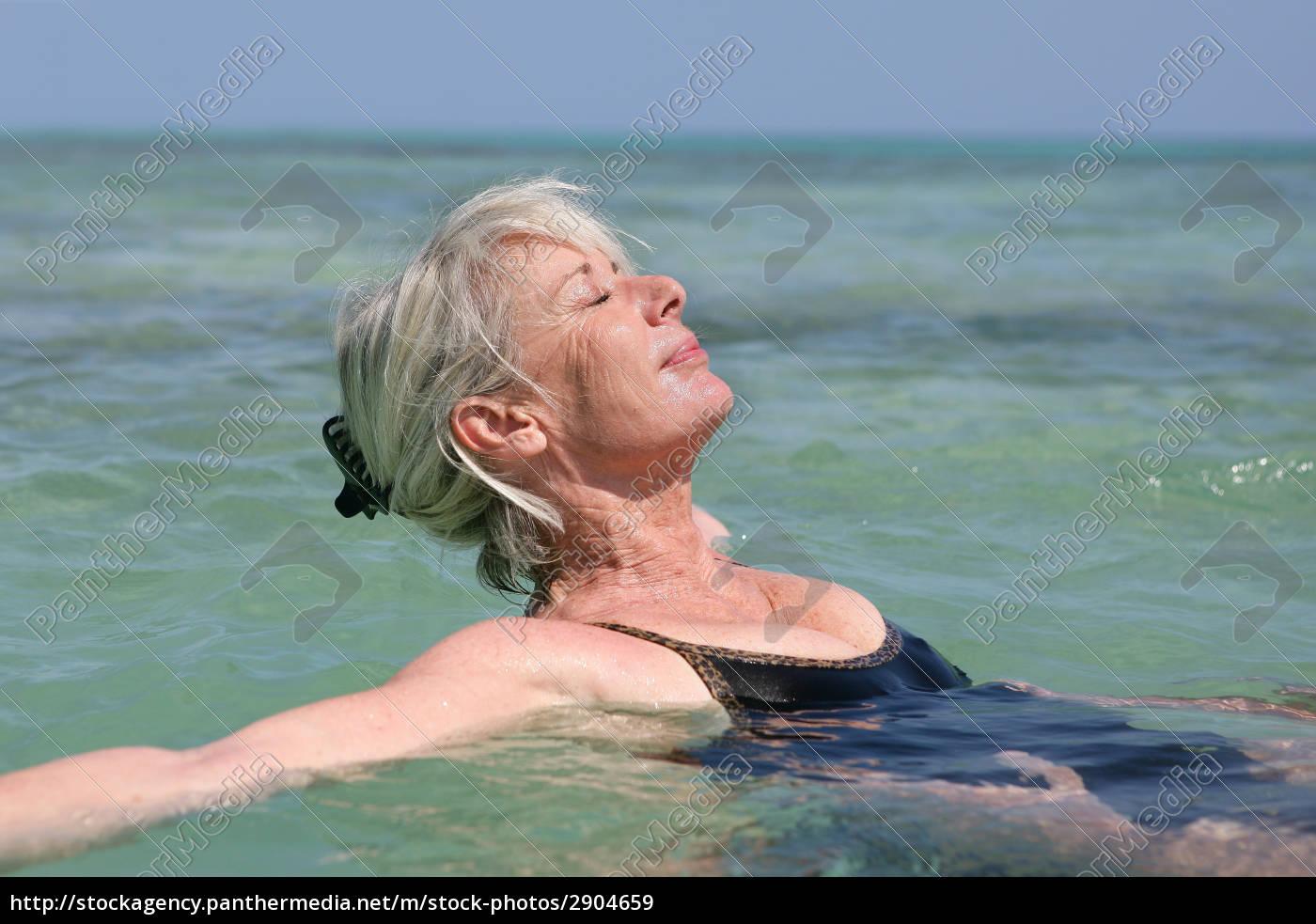 elderly, woman, bathing, in, the, sea - 2904659