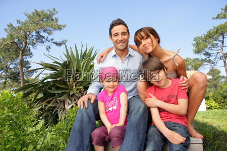 man, and, woman, with, smiling, children - 2906733