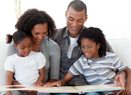 afro american family reading a book
