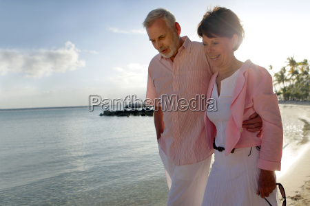 senior, couple, strolling, on, the, beach - 2908407