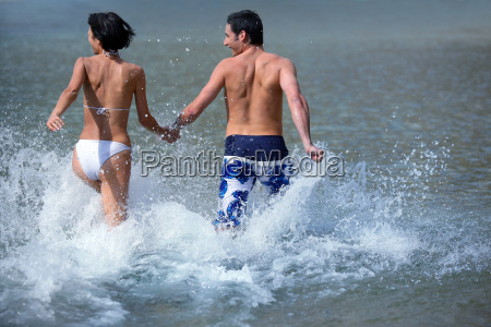 couple, in, swimsuits, in, the, water - 2913371