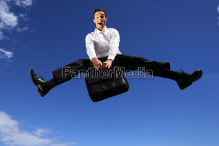 man, in, suit, with, briefcase, jumping - 2914127