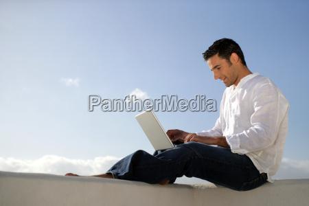 smiling, man, sitting, with, laptop, profile - 2914411
