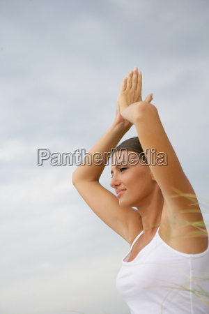 portrait, of, woman, meditating, by, lifting - 2916475