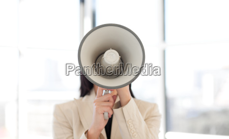 portrait of a businesswoman shouting through