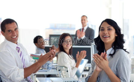 businessteam applauding a colleague after a