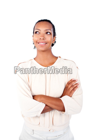 beautiful businesswoman with folded arms looking