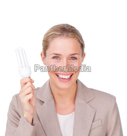 positive businesswoman holding a saving energy