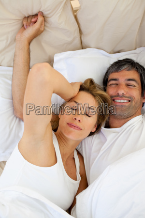beautiful couple waking up