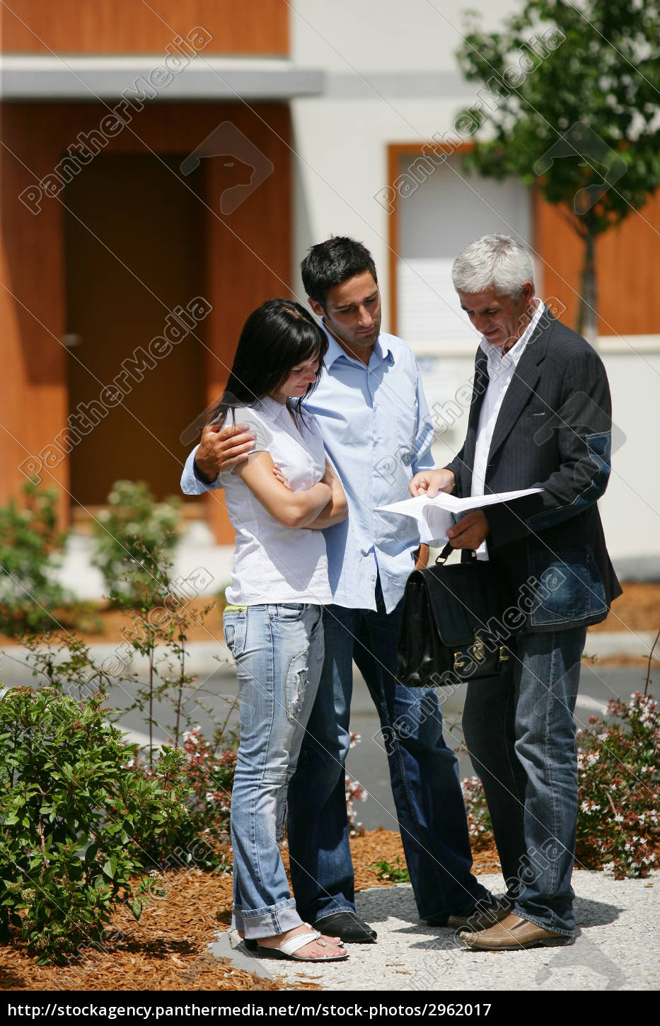 real, estate, agent, with, young, couple - 2962017