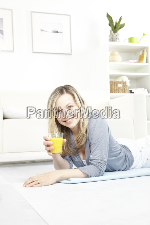 young, woman, drinking, orange, juice, on - 2982767