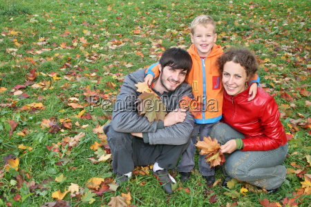 autumn family with stand boy