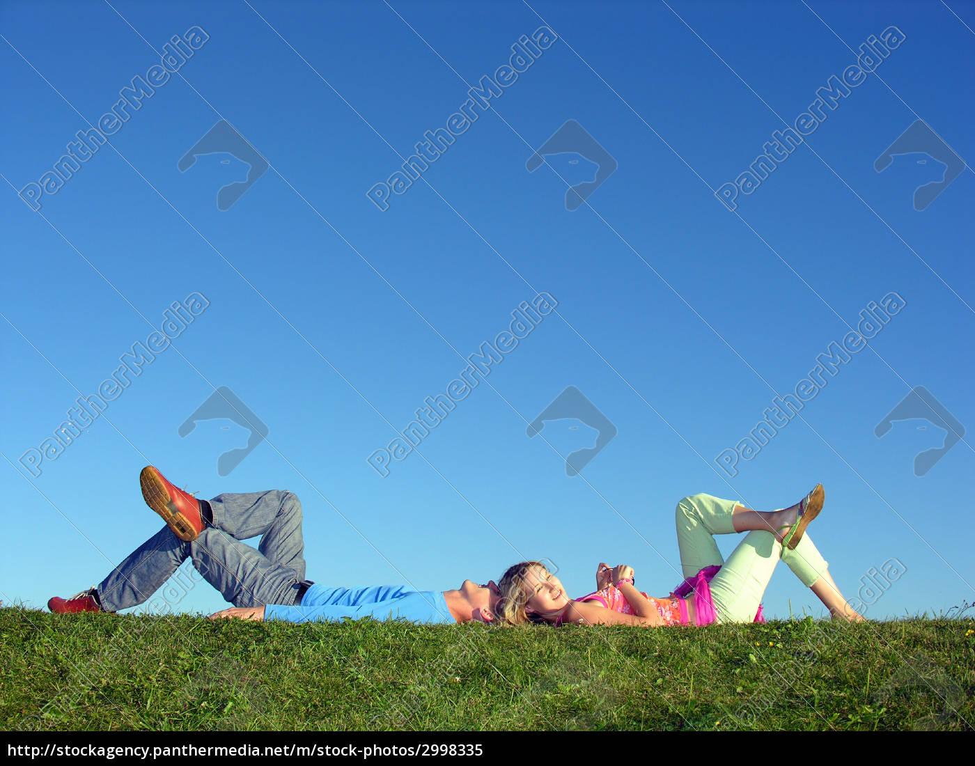 couple, lie, on, blue, sky, girl - 2998335